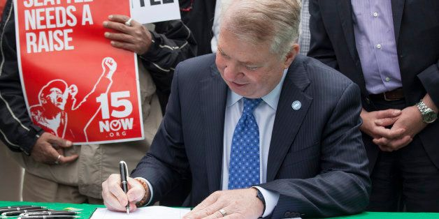 SEATTLE, WA - JUNE 3:  Seattle Mayor Ed Murray signs a bill that raises the city's minimum wage to $15 an hour on June 3, 201