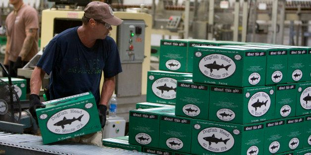 Employees work on the bottling line at the Dogfish Head Craft Brewery Inc. facility in Milton, Delaware, U.S., on Wednesday,
