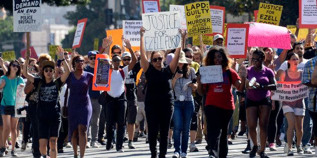 LOS ANGELES, CA - AUGUST 17: Demonstrators march in downtown Los Angeles protesting the police shooting death of 24-year-old