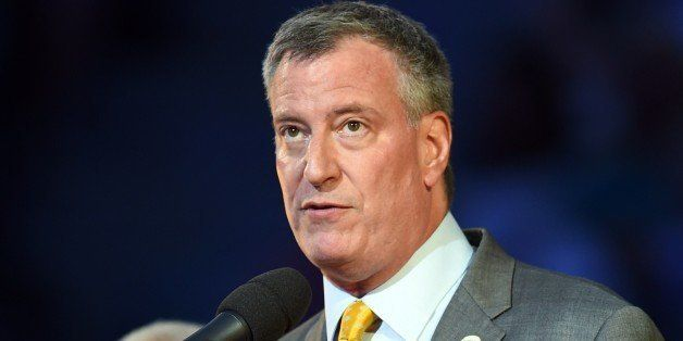 New York City Mayor Bill de Blasio participates in the opening ceremonies at the US Open 2014 at the USTA Billie Jean King Na