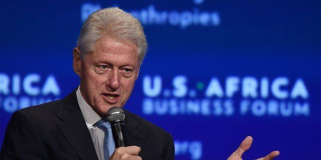 Former US President Bill Clinton moderates a panel discussion during US-Africa Business Forum on the sideline of the US-Afric
