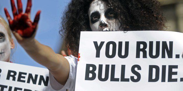 An activist of the People for the Ethical Treatment of Animals (PETA) and Anima Naturalis pro-animal groups, with a skull pai