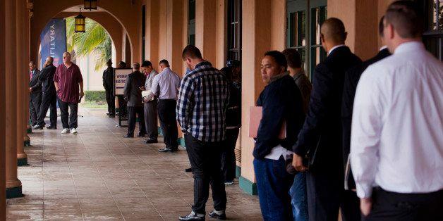 Job seekers line up for the Recruit Military veteran job fair in San Diego, California, U.S., on Thursday, Feb. 27, 2014. Mor