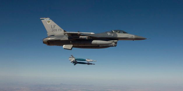 A 56th Fighter Wing F-16 Fighting Falcon from Luke Air Force Base, Arizona, releases two GBU-12 laser guided bombs during a t