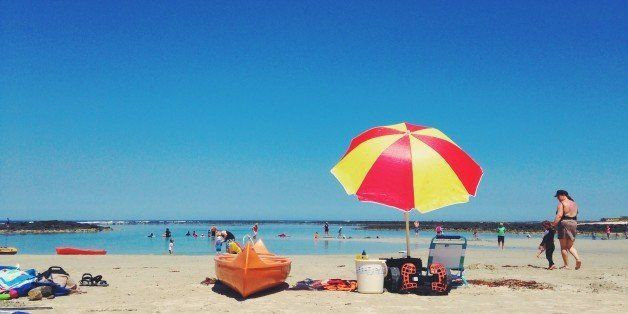 People enjoying the beach on hot summer day
