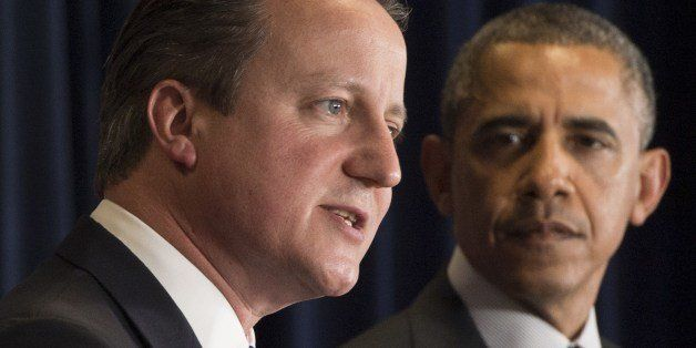 US President Barack Obama (R) and British Prime Minister David Cameron hold a joint press conference during the G7 Summit at