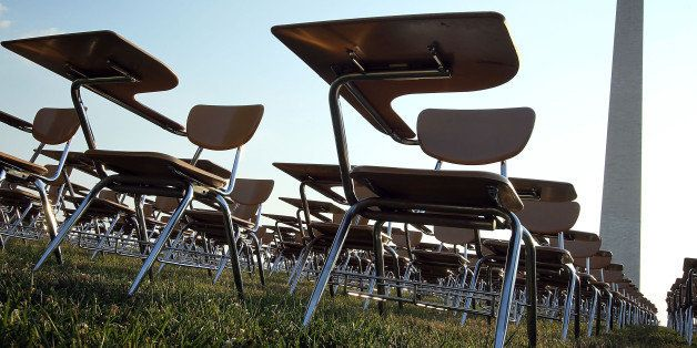 WASHINGTON, DC - JUNE 20:  An installation of 857 empty school desks, representing the number of students nationwide who are