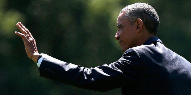 WASHINGTON, DC - AUGUST 29:  U.S. President Barack Obama departs the White House August 29, 2014 in Washington, DC. Obama is