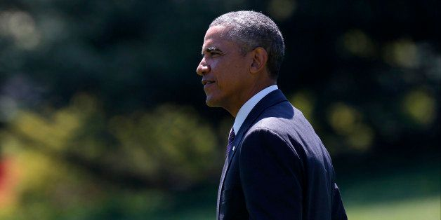 President Barack Obama walks on the South Lawn of the White House in Washington, Friday, Aug. 29, 2014, as he travels to West