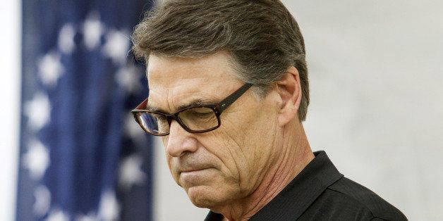 ROCHESTER, NH - AUGUST 23: Texas Gov. Rick Perry pauses during a GOP event August 23, 2014 in Rochester, New Hampshire. Perry