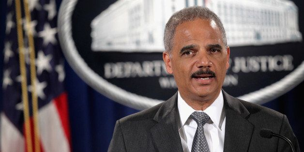 WASHINGTON, DC - AUGUST 21:  Attorney General Eric Holder makes a major financial fraud announcement during a press conferenc