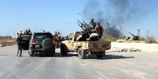 TRIPOLI, LIBYA - AUGUST 24: Militants of Fajr Libya (Libyan Dawn) coalition make an appearance at the entrance of the Interna
