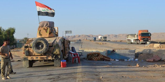 SALADIN, IRAQ - SEPTEMBER 07: Lorries and a tank are on the Kirkuk - Baghdad road in Suleiman Bey, town of Tuz Khurmato, Iraq