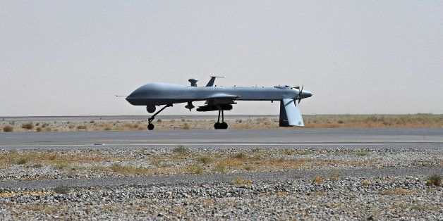 FILE - In this June 13, 2010, file photo a U.S. Predator unmanned drone armed with a missile stands on the tarmac of Kandahar