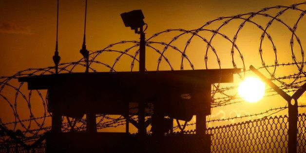 In this photo reviewed by the U.S. military, the sun rises above Camp Delta at Guantanamo Bay Naval Base, Cuba, Wednesday, No