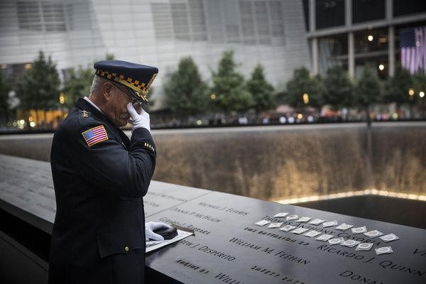 NEW YORK, NY - SEPTEMBER 11: Sam Pulia, mayor of Westerchester, IL, and a former police officer of the same town, mourns over
