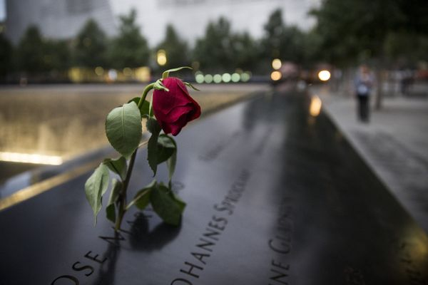 NEW YORK, NY - SEPTEMBER 11: A wilting rose is left in remembrance of those lost before the memorial observances held at the
