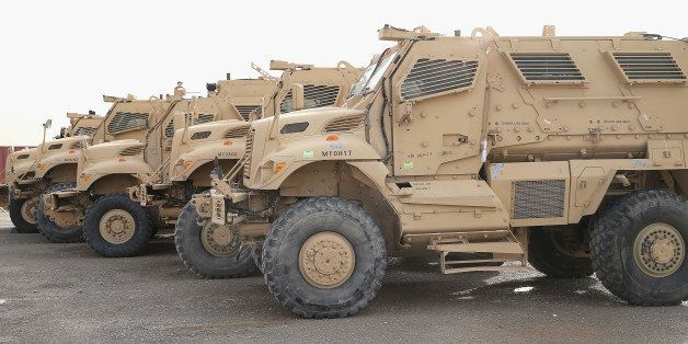 KANDAHAR, AFGHANISTAN - MARCH 08:  MRAP vehicles sit in the Redistribution Property Accountability Team (RPAT) yard at Kandah