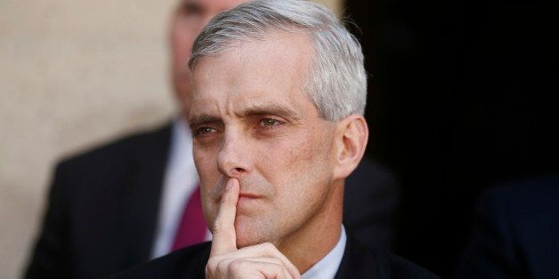 FILE - In this Oct. 28, 2013 file photo, White House Chief of Staff Denis McDonough listens as President Barack Obama speaks
