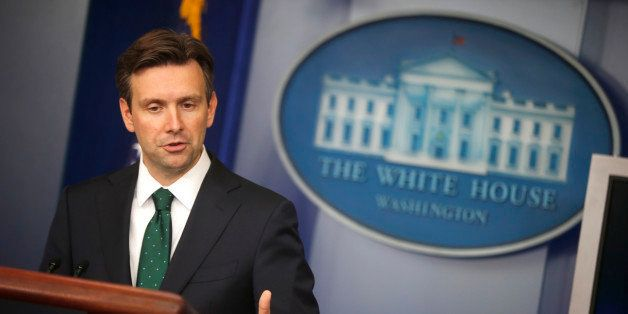 White House press secretary Josh Earnest speaks to reporters during the daily press briefing at the White House in Washington