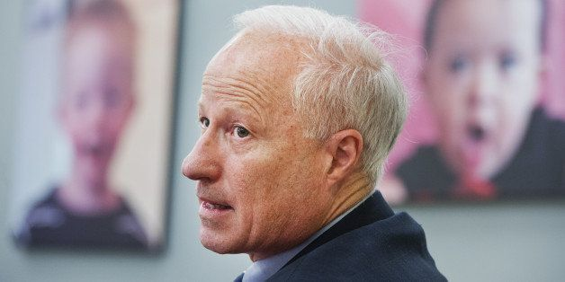 UNITED STATES - AUGUST 29: Rep. Mike Coffman, R-Colo., talks with officials during a tour of the University of Colorado Ansch