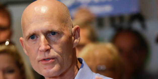 Florida Gov. Rick Scott speaks at a campaign event Monday, Sept. 8, 2014, in Winter Park, Fla.  Scott is running against form
