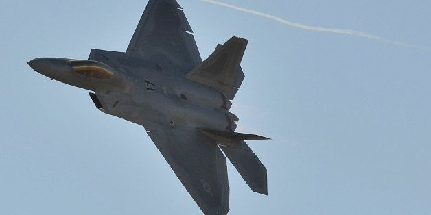A US Air Force F-22 Raptor roars through the sky during the Australian International Airshow in Melbourne on March 1, 2013. 1