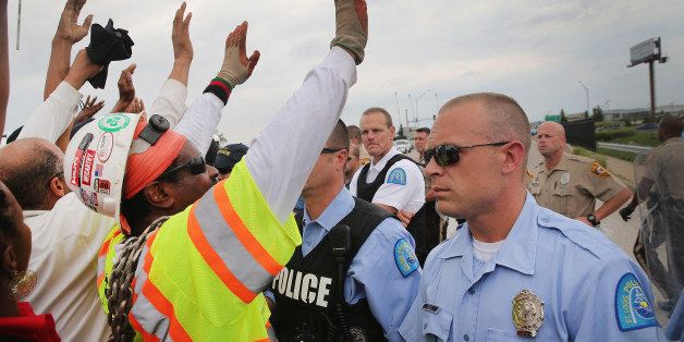 FERGUSON, MO - SEPTEMBER 10:  Police block demonstrators from gaining access to Interstate Highway 70 on September 10, 2014 n