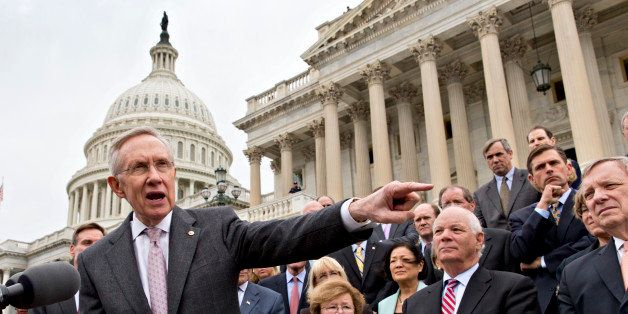 Senate Majority Leader Harry Reid, D-Nev., and Senate Democrats gather outside the Capitol to urge Speaker of the House John