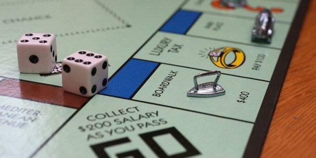 FAIRFAX, CA - FEBRUARY 06:  In this photo illustration, The Monopoly iron game piece is displayed on February 6, 2013 in Fair