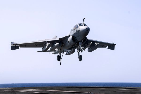 An EA-6B Prowler attached to the Garudas of Electronic Attack Squadron 134 lands aboard the aircraft carrier USS George H.W.
