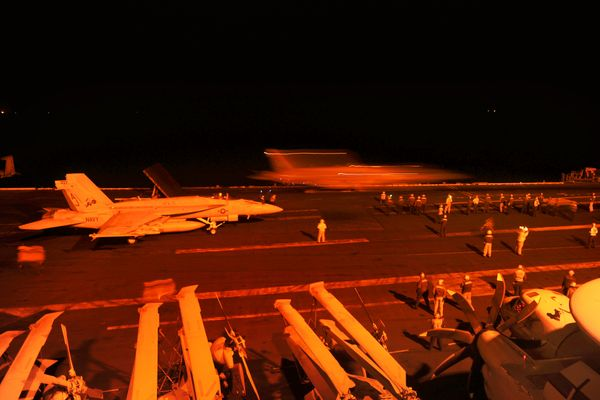 An F/A-18E Super Hornet attached to Strike Fighter Squadron 31 and an F/A-18F Super Hornet attached to Strike Fighter Squadro