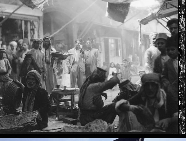 In this undated handout photo provided by the Library of Congress taken during the autumn of 1932, Iraqis pause in the market