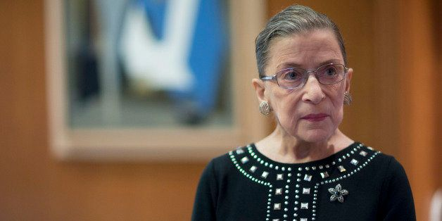 Ruth Bader Ginsburg, associate justice of the U.S. Supreme Court, stands in her chambers following an interview in Washington