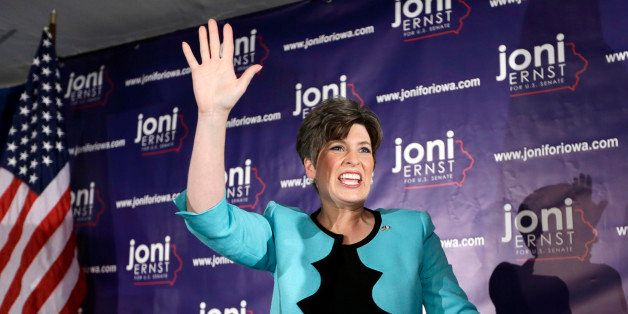 State Sen. Joni Ernst waves to supporters at a primary election night rally after winning the Republican nomination for the U