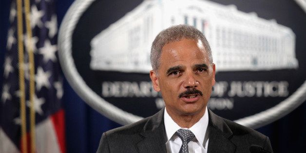 WASHINGTON, DC - AUGUST 21:  Attorney General Eric Holder makes a separated statement on the unrest after the unarmed 18-year