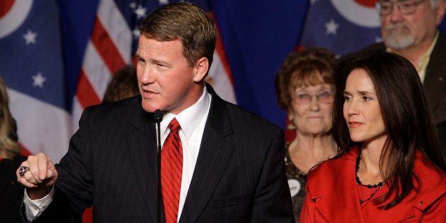 Republican Ohio Secretary of State-elect Jon Husted, left, with his wife Tina, speaks to a crowd of supporters at the Ohio Re