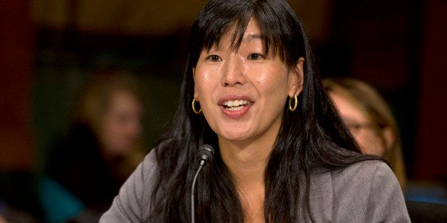 Ai-jen Poo, director of the National Domestic Workers Alliance, testifies at a Senate Judiciary Committee hearing on immigran