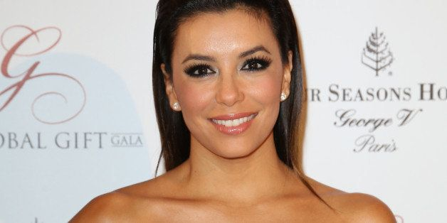 Eva Longoria poses during a photocall for Global Gift Foundation, Monday May 12, 2014 in Paris. The Global Gift Foundation is