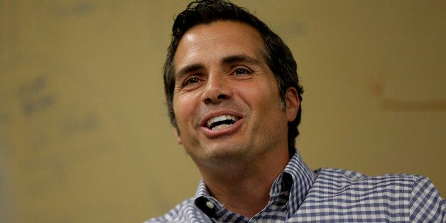 Independent U.S. Senate candidate Greg Orman talks to workers at a healthcare company, Wednesday, Sept. 10, 2014, Overland Pa