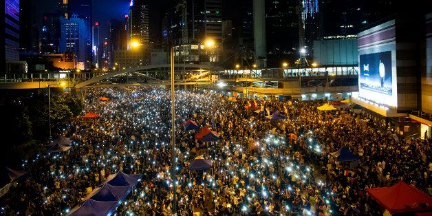 HONG KONG, HONG KONG SAR, CHINA - OCTOBER 01: Demonstrators hold high lit cellphones to form a 'sea of lights' in Admirality,
