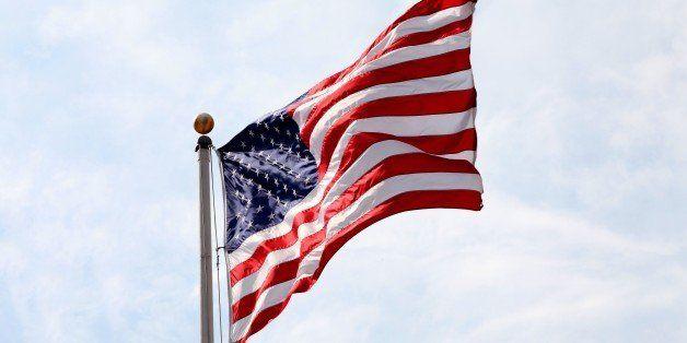 MILWAUKEE - SEPTEMBER 20:  An American Flag flies outside the US Bank Center on September 20, 2014 in Milwaukee, Wisconsin. (