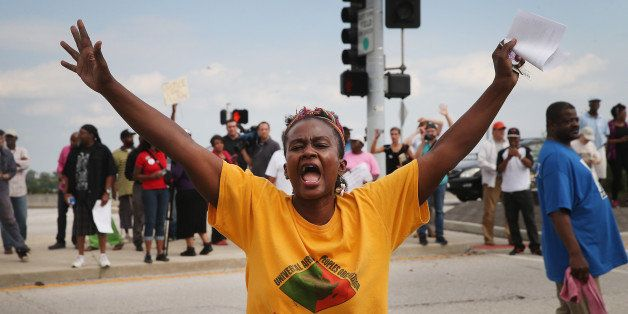 FERGUSON, MO - SEPTEMBER 10:  Demonstrators protest near a ramp which leads onto Interstate Highway 70 on September 10, 2014