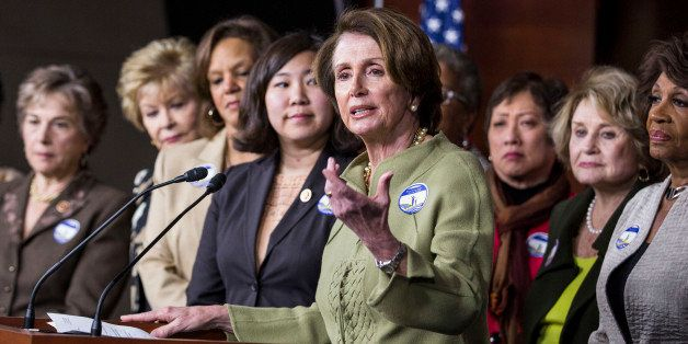 WASHINGTON, DC - APRIL 8:  House Minority Leader Nancy Pelosi (D-CA) (4th R) speaks during a news conference to mark Equal Pa