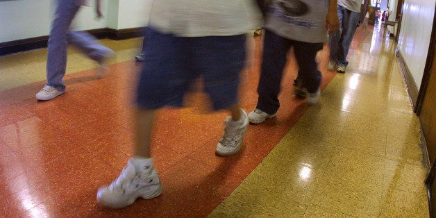 391429 07: Students hustle through a hallway between classes during summer school July 3, 2001 at Brentano Academy in Chicago