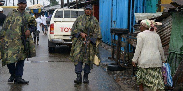 Liberian soldiers patrol in Monrovia's West Point slum on September 6, 2014. The death toll from the Ebola epidemic has climb