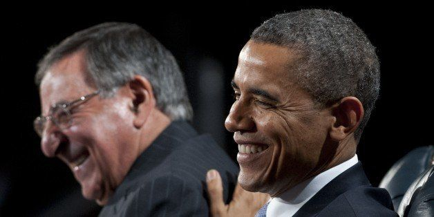 US President Barack Obama laughs with outgoing Defense Secretary Leon Panetta (L) during an Armed Forces Farewell Tribute in