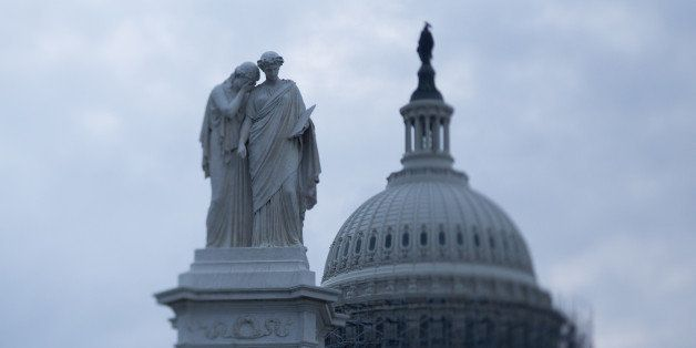 The Peace Monument memorial stands in front of the U.S. Capitol Building in this photo taken with a tilt-shift lens in Washin
