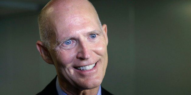 Florida Gov. Rick Scott speaks with members of the media, Monday, Sept. 22, 2014 at the University of Miami Miller School of