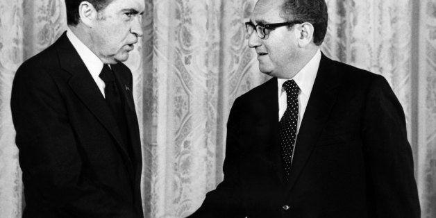 WASHINGTON - SEPTEMBER 1973:  US president Richard Nixon (L) shakes hands with Henry Kissinger, foreign Secretary of State, S